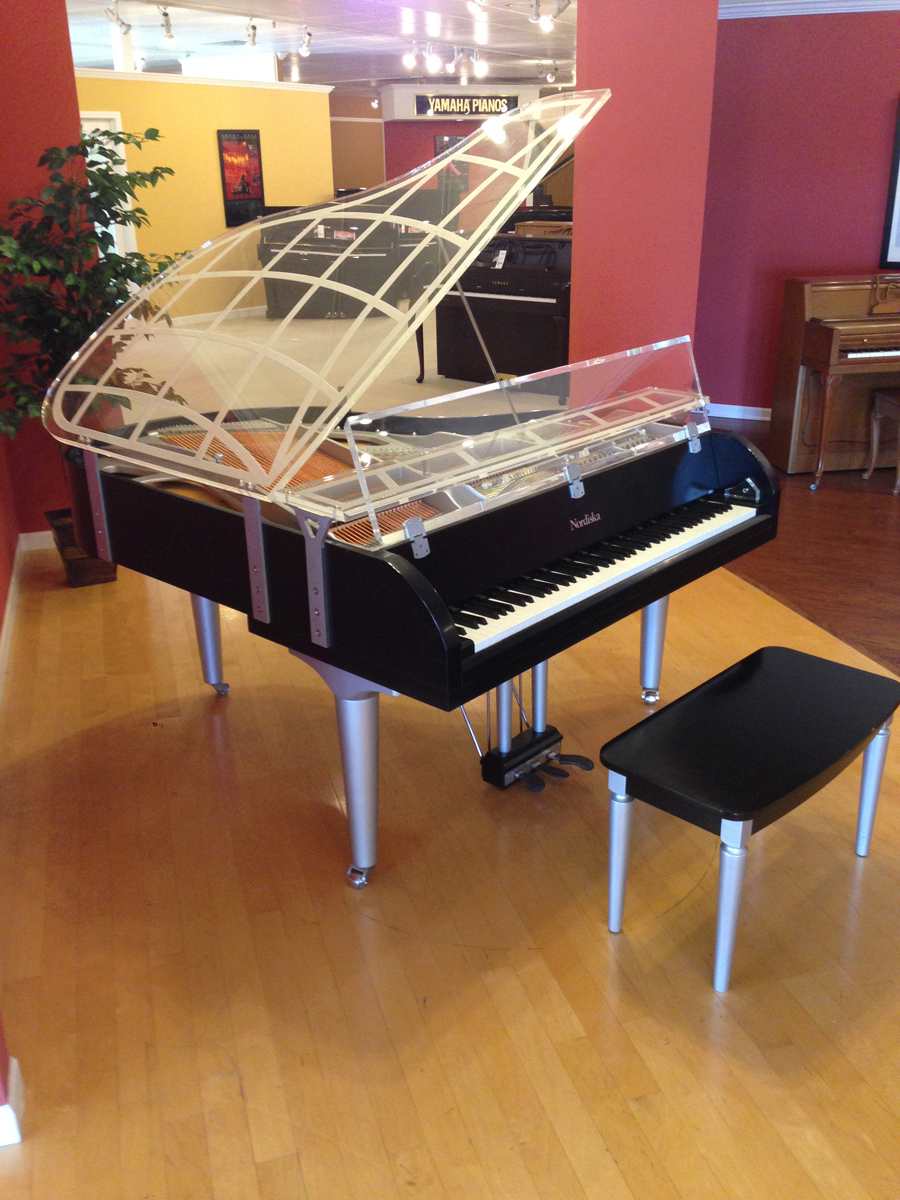 a clear baby grand piano